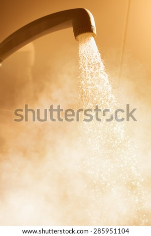 hot shower with flowing water and steam