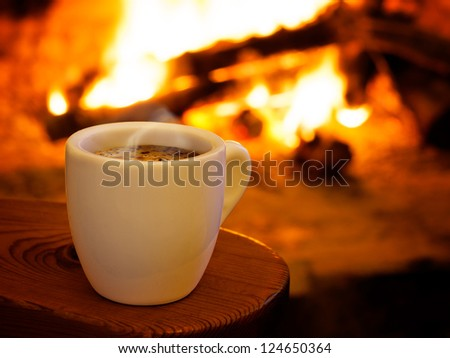 Hot smoking coffee by fireplace