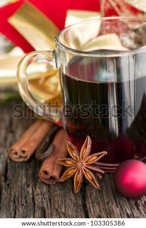 Hot spiced wine on wooden ground