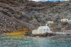 Hot springs of  Palea Kameni near with volcano and small  church of Saint Nikolas. Located in the Caldera of Santorini(Thira) island.Cyclades.Greece.Europe.