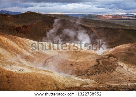Hot steaming geothermal vent or fumarole on rhyolite formation at Krafla volcanic area in Mývatn region, Northeastern Iceland, Scandinavia