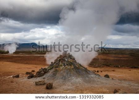 Hot steaming mud volcano or mud dome at Námafjall Hverir geothermal area in Mývatn region, Northeastern Iceland, Scandinavia