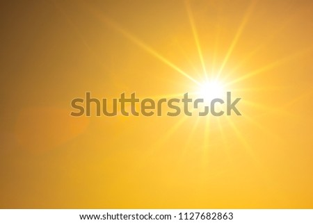 Hot summer or heat wave background, orange sky with glowing sun #1127682863