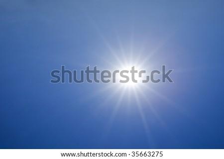 Hot sun over deep blue sky background #35663275