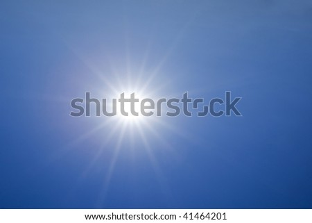 Hot sun over deep blue sky background - stock photo
