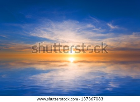 Hot sunset on lake over water surface