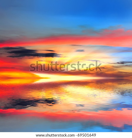 Hot sunset over lake water
