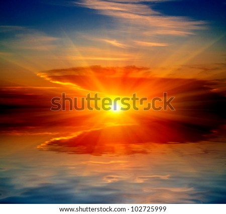 hot sunset over water in lake - stock photo