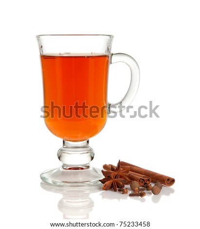Hot tea in glass cup and spice on white background