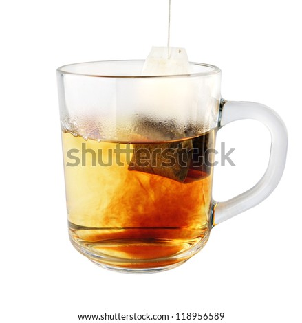 hot tea in glass mug with packet isolated on white
