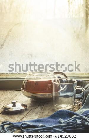 hot tea on the windowsill in...