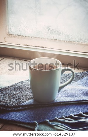 hot tea on the windowsill in the Cup. selective focus.
