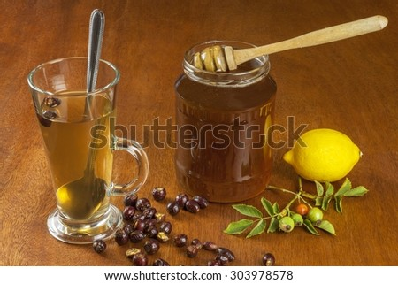 Hot tea with lemon and red arrow in the table. Home treatment for colds and flu. Treating colds using traditional recipes.