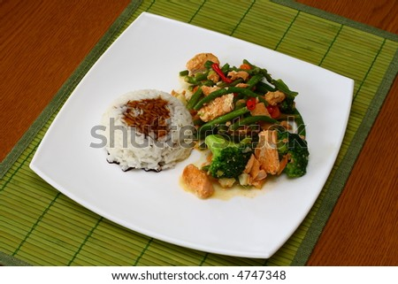 Hot Thai food - salmon with rice and vegetables