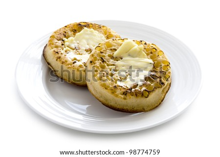hot toasted crumpets with butter on a white background