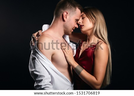 hot tongue. young couple has passionate interest, passionate love affair. isolated black background