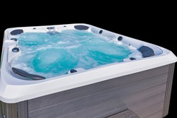 Hot tub, running jets, bubbly emerald green water, isolated on black back ground.