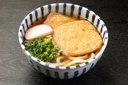 hot whitewheat? noodles with deep-fried Tofu? in bonito broth    [kitsune udon]