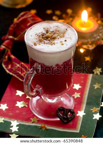 Hot winter drink with cream. Christmas decoration on background
