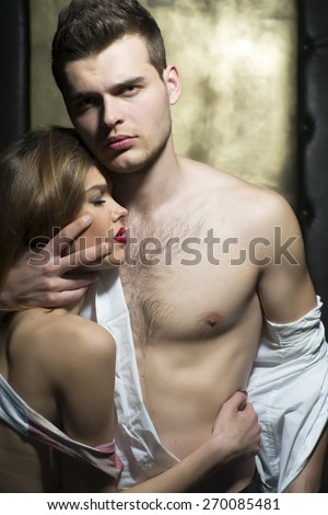 Hot young couple with beautiful bodies, vertical picture