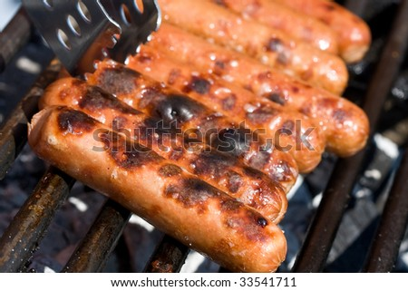 hotdogs on the grill outdoor on a small grill