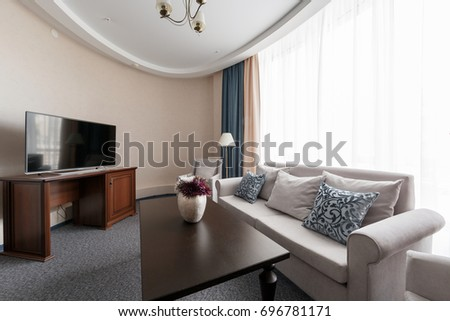 Hotel apartment, living room interior in the morning #696781171