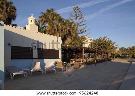 hotel bar and esplanade near the swimming pooll with parasol and sunbeds, Algarve, Portugal