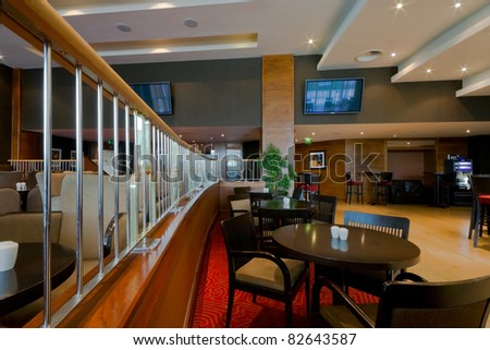 Hotel bar-restaurant interior with chairs and tables