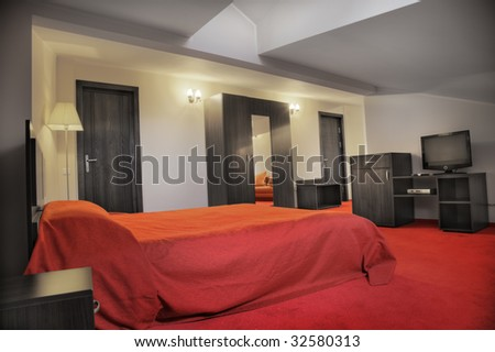 hotel bedroom in colors red and grey empty - stock photo