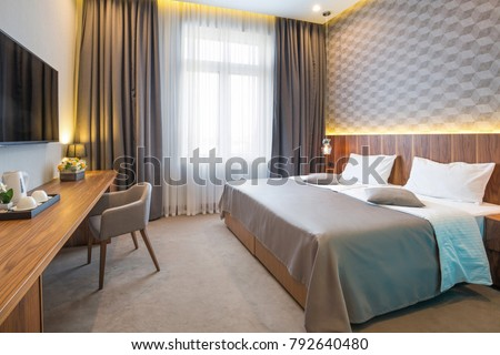 Hotel bedroom interior in the morning #792640480