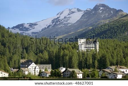 hotel building in mountain resort davos switzerland with impressive peak and glacier in background
