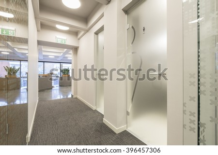 Hotel Corridor With Glass Toilet Door 396457306