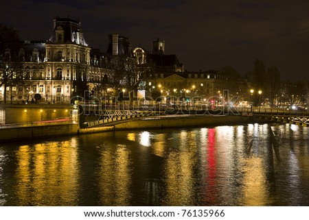 Hotel de Ville (City Hall of Paris) and Seine river at night, Paris, France