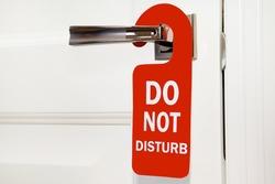 Hotel do not disturb red sign on white door