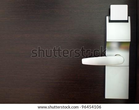 Hotel electronic lock on wooden door - stock photo