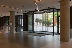 Hotel entrance interior, glass automatic sliding doors