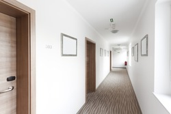 hotel hallway with many doors