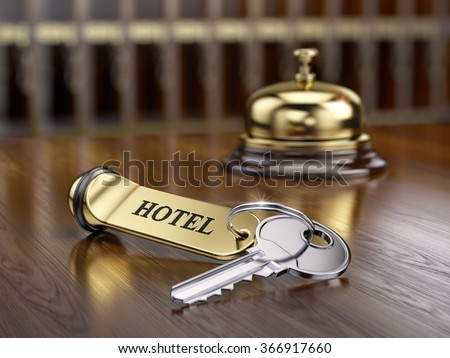 hotel key and reception bell on ...