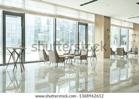 Hotel lobby interior with reception desk, sofas, marble floor and long bar. #1368962612