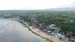 Hotel, motel and sea shore are showing in a drone picture. It's a beautiful place to stay for tourists.