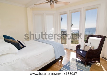 hotel or residential bedroom with gorgeous view of the ocean - stock photo