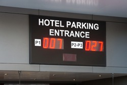 Hotel parking entrance electronic sign showing how many parking spaces are available that are free and unreserved