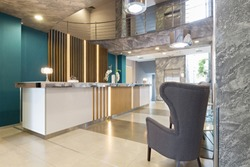 Hotel reception area interior with reception desk