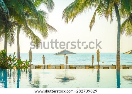 hotel resort pool on sunrise...