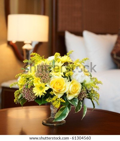 Hotel room arranged with yellow flowers #61304560