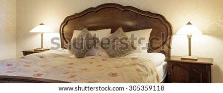 Hotel room bedroom with antique furniture