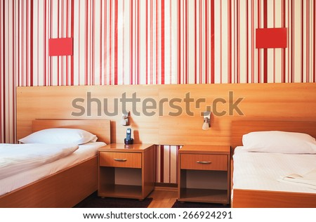 Hotel room interior, calm and peaceful atmosphere in red and white.