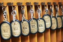 hotel room keys at reception desk counter