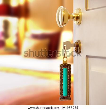 doorway with key and keyring key fob in open door and bedroom