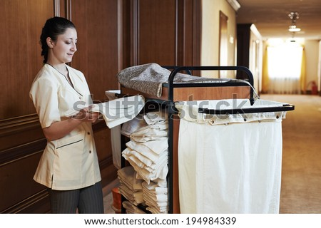 Hotel room service female housekeeping worker with for Hotel room service cart